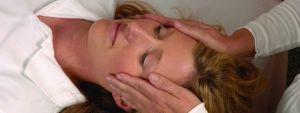 Woman receiving Healing Touch